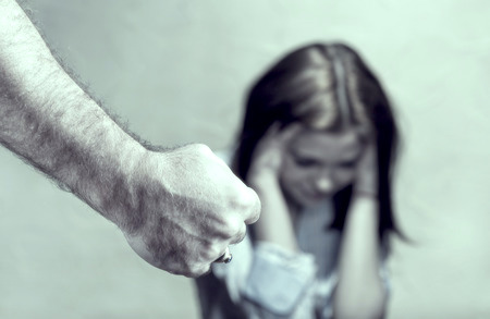 a female victim of sexual abuse trauma and male fist
