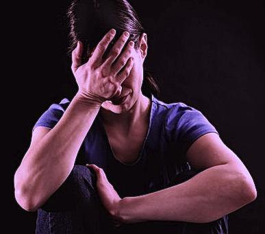 traumatized woman crying in emotional denial