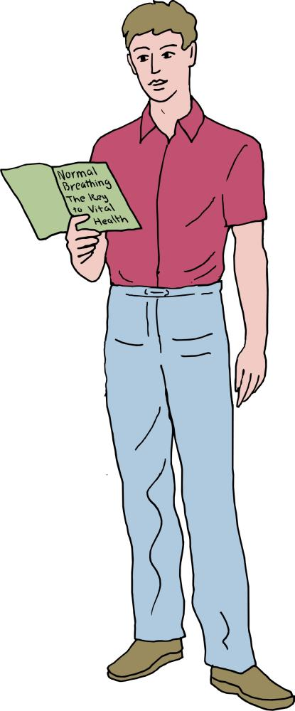 young man standing reading Buteyko book, Normal breathing: the key to vital health