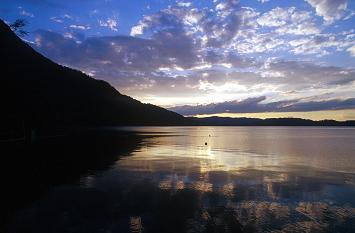 Evening landscape during sunset with a lake and mountain