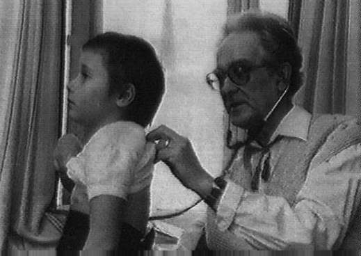 Doctor Konstantin Buteyko, leading Soviet physiologist, author of the Buteyko breating method, with a child.