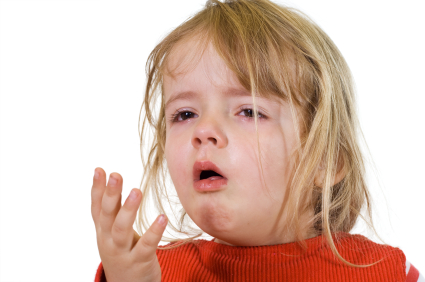 Girl with bronchial asthma coughing