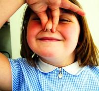 Young girl showing breath holding