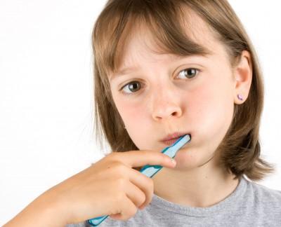Girl tooth brushing