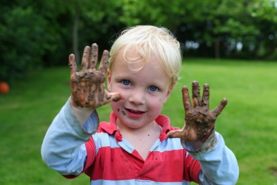 Boy with dirty hands grounded himself