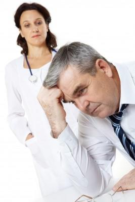 Older man with depression and his doctor