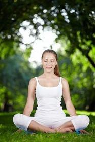 Woman meditates, calms her mind and nerves