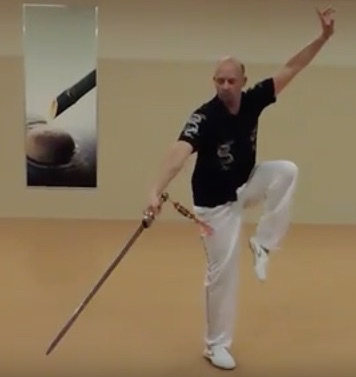Volker demonstrates Tai Chi breathing pattern benefits with sword and focused movements