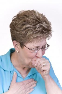 Woman coughing with acute asthma exacerbation symptoms