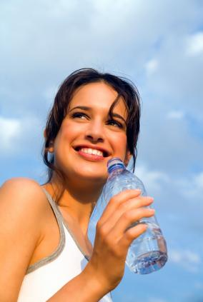 Woman smiling during exercise with good physical health