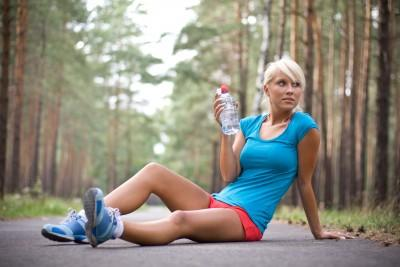 Athletic woman with leg cramps
