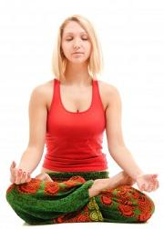 Young woman practicing yoga breathing exercises