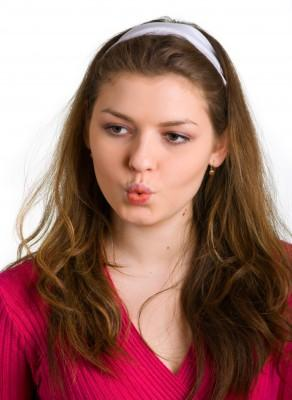 Young woman practicing pursed lip breathing